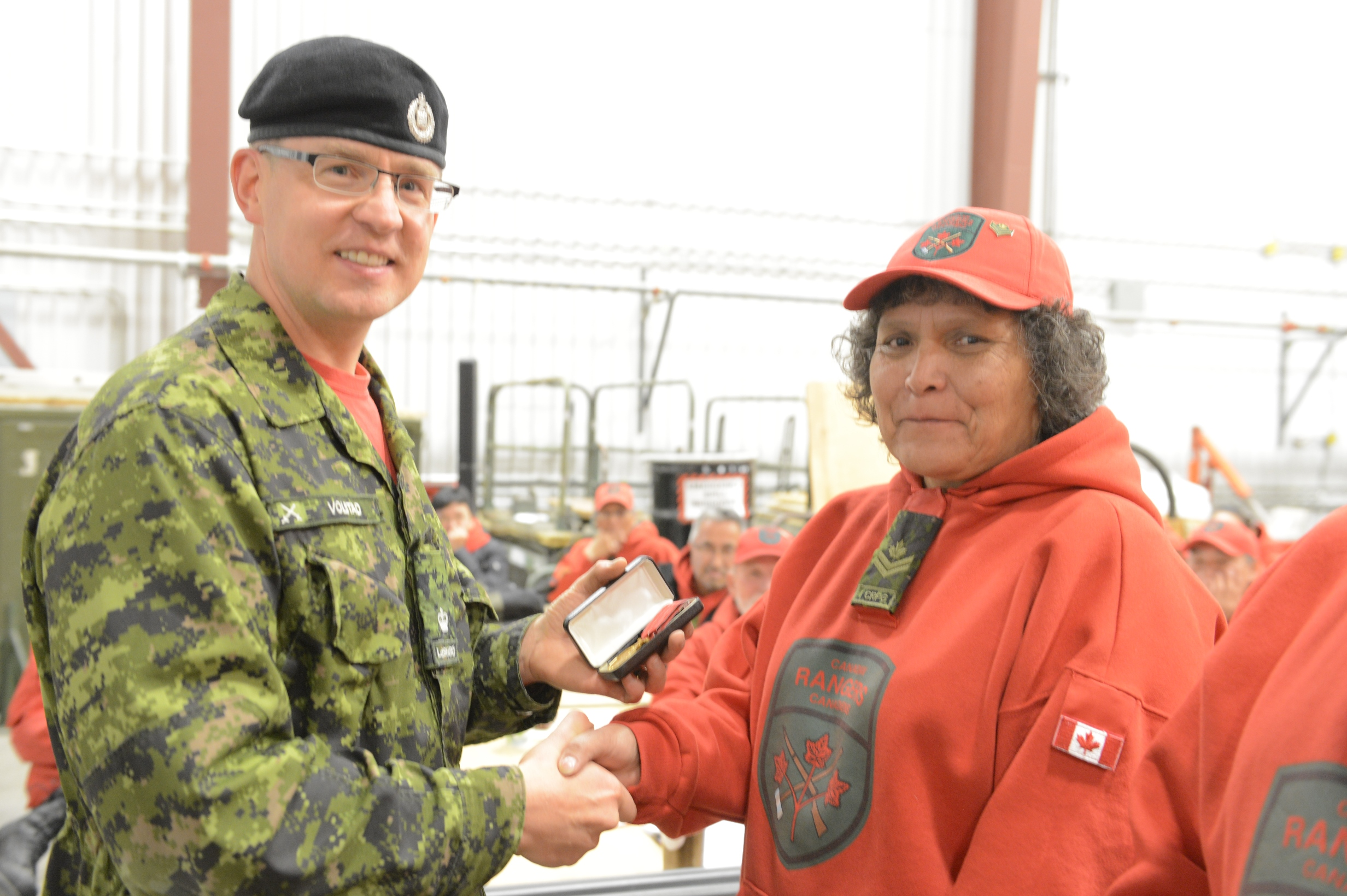 "Major Craig Volstad, Commanding Officer, 1 Canadian Ranger Patrol Group, presents Ranger Master Corporal Therese ""Dollie"" Simon with the Canadian Forces Decoration on October 8, 2015 in Yellowknife, NT. Photo by: Captain Steve Watton, 1st Canadian Ranger Patrol Group. ©2015 DND/MDN Canada."