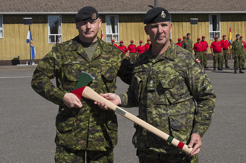 LCol Tim Byers (right) receives his Commander's Axe from LCol Russ Meades (left), commemorating his 12 year tenure as Commanding Officer  during the 4th Canadian Ranger Patrol Group's Change of Command ceremony on 26 June 2016.  LCol Byers was the Commanding Officer of 4 CRPG from 01 May 2004 – 26 June 2016. 
