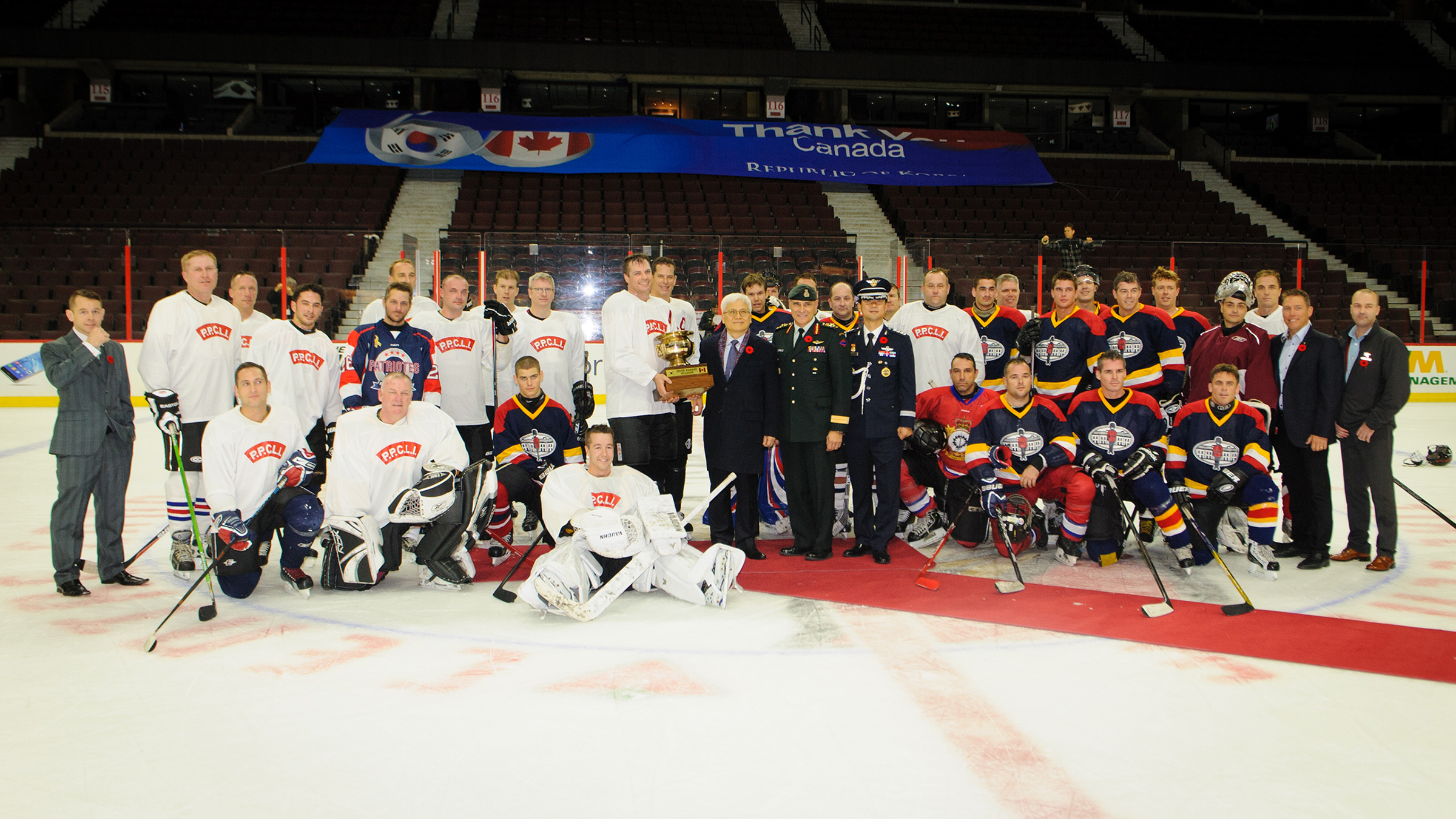 The Imjin River Memorial Cup is presented to the Princess Patricia's Canadian Light Infantry hockey team by Korean Ambassador, Daeshik Jo for the victory against the Royal 22e Régiment in the Imjin Classic hockey game held at the Canadian Tire Centre on November 5, 2016. Photo by: Daniel Merrell, Canadian Forces Support Unit (Ottawa). ©2016 DND/MDN Canada.