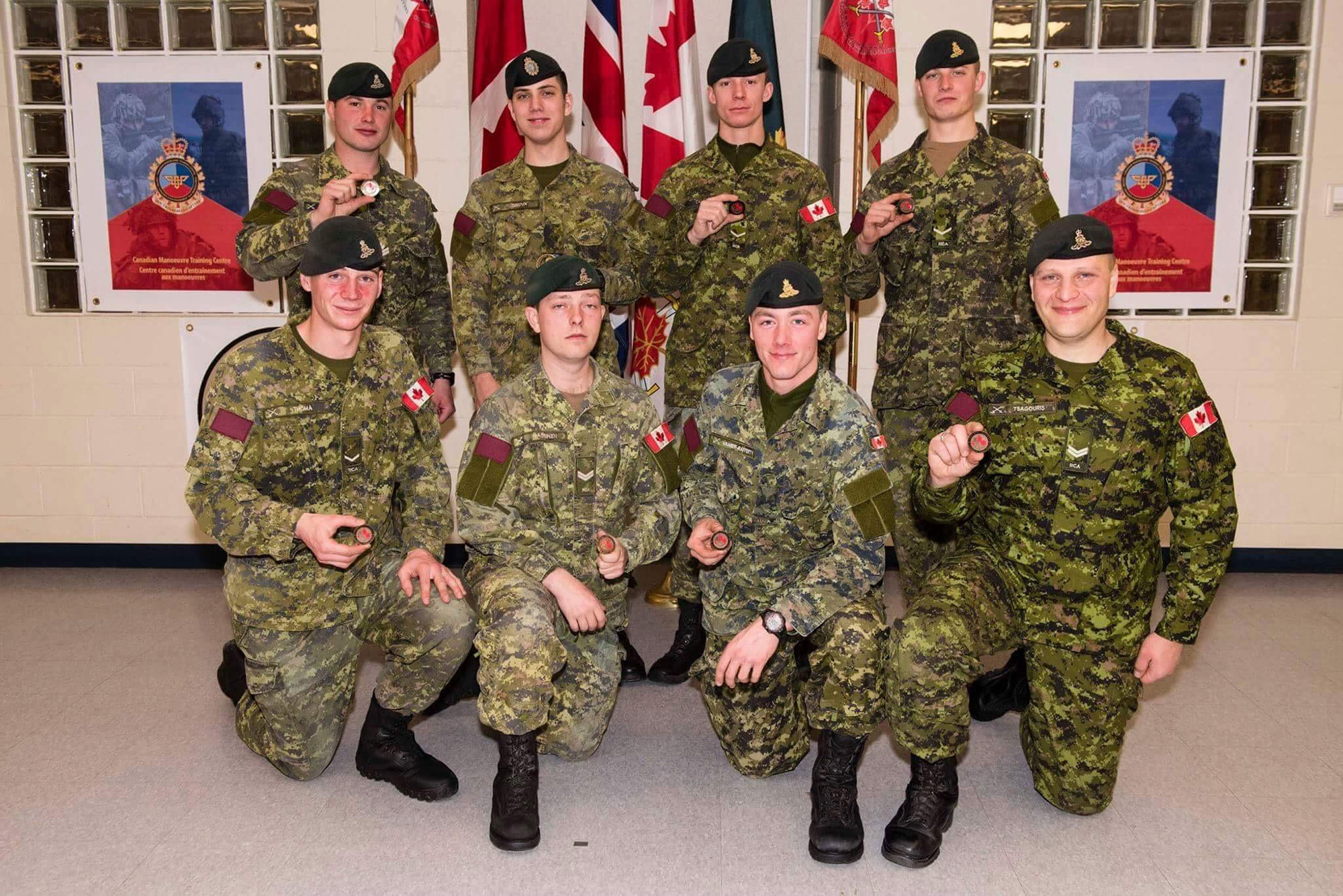 The eight member Canadian Patrol Concentration (CPC) team from 4th Artillery Regiment (General Support), RCA (4 Regt (GS)) displaying their medals after a superb performance of skill and determination. Photo source: DND.