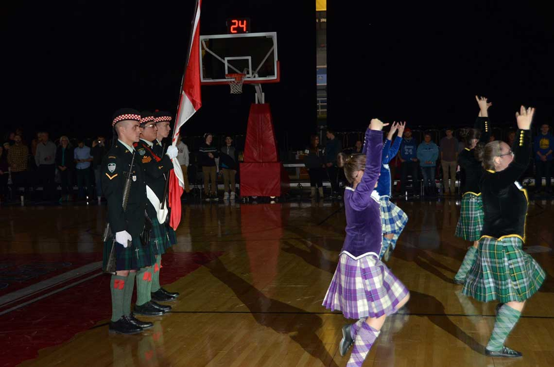 The Cape Breton Highlanders Flag Party stands at attention as Highland dancers perform before the first Cape Breton Highlanders basketball game at Centre 200, Sydney, N.S. on December 27, 2016. 