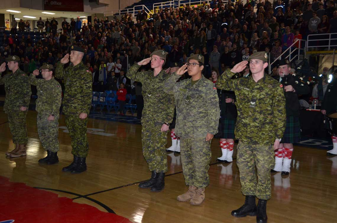 Members of Cape Breton Highlanders salute while the national anthem is played before the first Cape Breton Highlanders basketball game at Centre 200, Sydney, N.S. on December 27, 2016. 