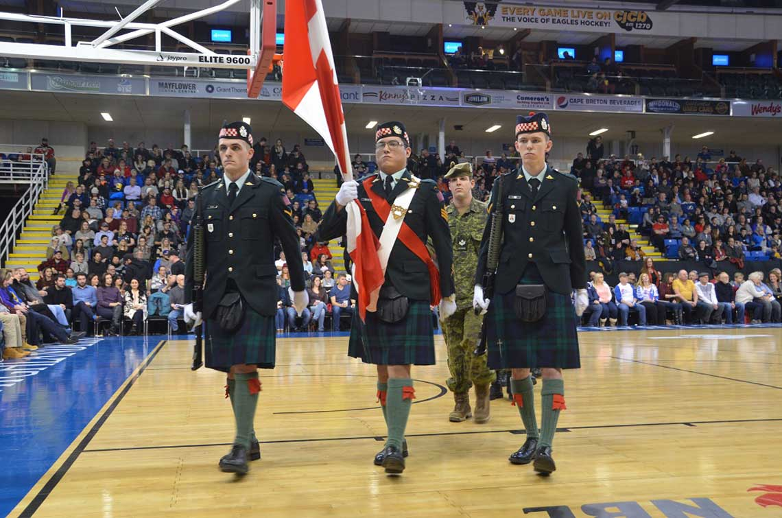 Cape Breton Highlanders members march off for the commencement of the first Cape Breton Highlander basketball game at Centre 200, Sydney, N.S. on December 27, 2016. 