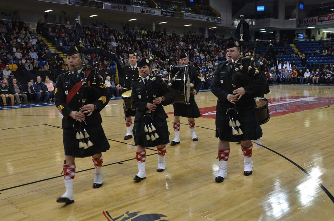 The Cape Breton Highlanders' Pipes and Drums marches off before the first Cape Breton Highlanders basketball game at Centre 200, Sydney, N.S. on December 27, 2016. 