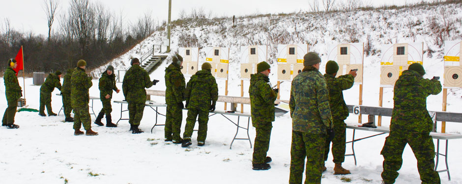 Slide - Students in the Army Technical Warrant Officer Program (ATWOP) conduct pistol trials