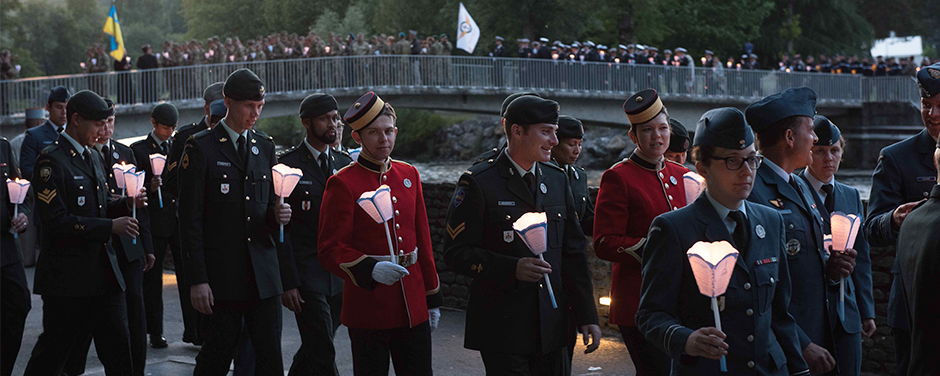 Slide - The Canadian Armed Forces Contingent participates in the candlelight procession