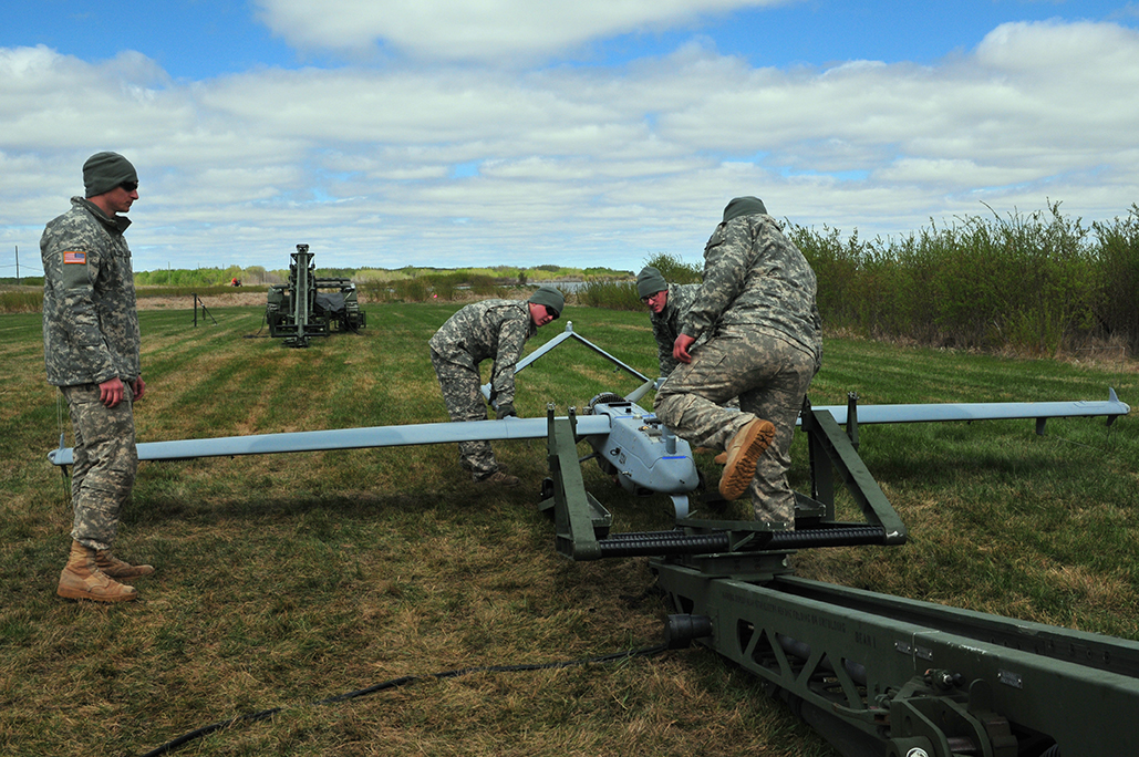 Soldiers from Detachment 1, Company D, 173rd Brigade Engineer Battalion, Tactical Unmanned Aerial Systems in Camp Williams, Wisconsin, load a RQ7B Shadow onto its launcher in preparation for a flight during Exercise MAPLE RESOLVE on May 17, 2017.  More than 650 United States Army Soldiers supported MAPLE RESOLVE 17, the Canadian Army's premiere brigade-level validation exercise that ran from May 14 to 29.