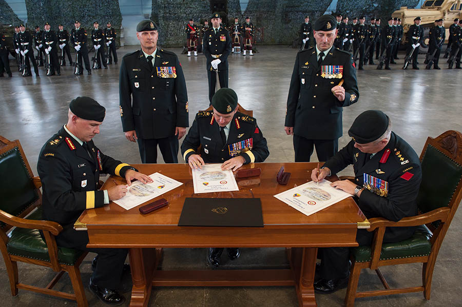 Colonel John Errington officially assumes command of the Combat Training Centre from Brigadier-General Craig Aitchison at a ceremony presided over by Major-General Simon Hetherington, Commander of the Canadian Army Doctrine and Training Centre, held at 5th Canadian Division Support Base Gagetown in Oromocto, New Brunswick on June 23, 2017.