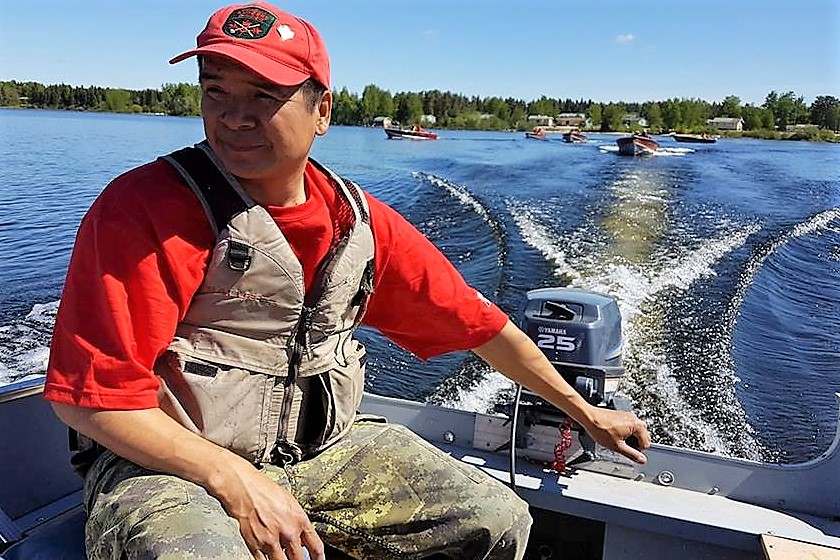 Sergeant Jason Roundhead of North Caribou Lake leads a group of Canadian Ranger boats