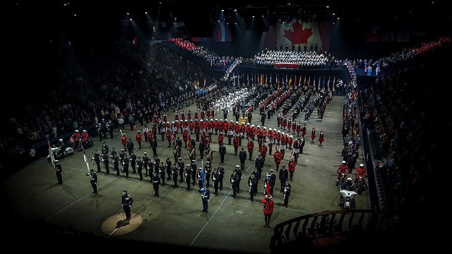 Performers carry the Canada 150 flag during the opening act of the Royal Nova Scotia International Tattoo on 5 July 2017 at Scotiabank Centre in Halifax, Nova Scotia.