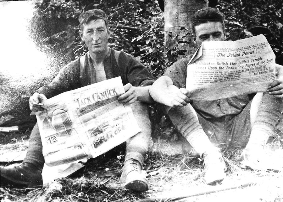 Jack Turner (left) and Lee Allan pictured catching up on news from home during a pause in fighting. Mr. Turner, a Prince Edward Island native, snuck a camera onto the front lines of the First World War. 