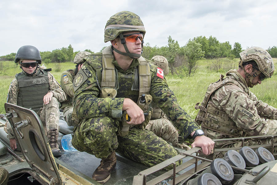 Major Christopher Hartwick mentors Ukrainian Armed Forces troops during a live fire exercise