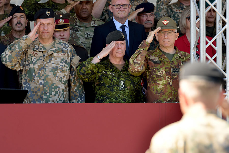 General Jonathan Vance, Canadian Chief of the Defence Staff stands with Major General Leonīds Kalninš, Latvian Chief of Defence of the National Armed Forces; (L) and General Claudio Graziano, Italian Chief of Defence, (R) during a ceremony marking the standup of the enhanced Forward Presence Battlegroup Latvia at Camp Ādaži, Latvia, on June 19, 2017. 