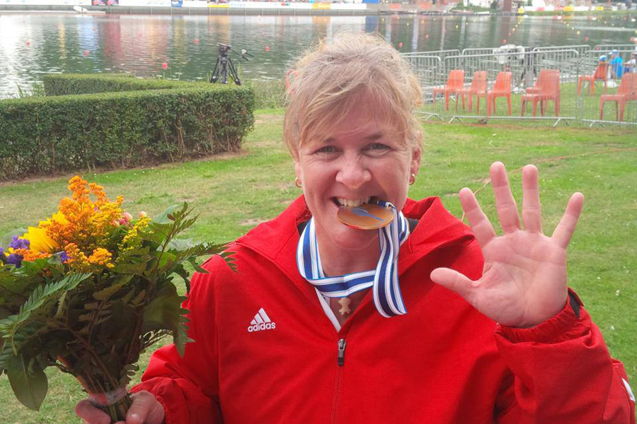 Christine Gauthier, world champion para canoer at Duisburg, Germany in August 2013. She also plays sledge hockey, cross-country sit ski, hand cycles as cross training for paddling, and enjoys riding her three-wheel motorcycle. Photo: Christine Bain, CKC.