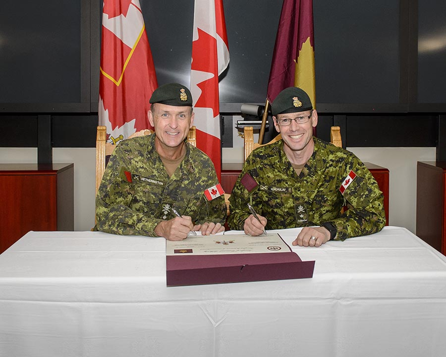 Major-General Simon Hetherington (left), Commander of Canadian Army Doctrine and Training Centre (CADTC) transfers Command Authority for Canadian Combat Support Brigade to 5th Canadian Division Commander, Brigadier-General Derek Macaulay (right). October 4, 2017 at Korea Hall, Fort Frontenac, Kingston, Ontario. Photo: Steven McQuaid, CFB Kingston Base Photo ©2017 DND/MDN Canada.