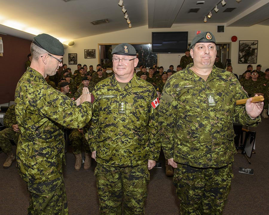 Brigadier-General Derek Macaulay places the 5th Canadian Division patch on Colonel Marc LaFortune, Commander of the Canadian Combat Support Brigade at the Transfer of Command Authority ceremony held on October 4, 2017 at Korea Hall, Fort Frontenac, Kingston, Ontario. Photo: Steven McQuaid, CFB Kingston Base Photo ©2017 DND/MDN Canada.