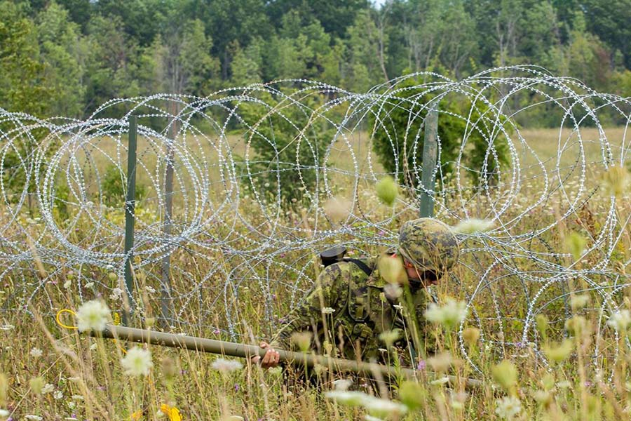 a soldier with razor wire