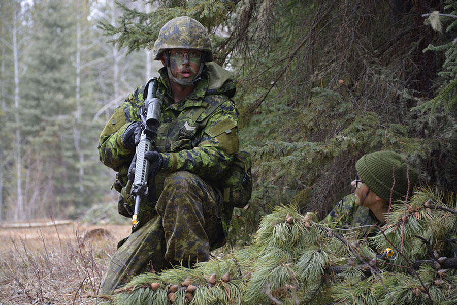 Corporal Andrew Noel, of 41 Service Battalion in Alberta, confirms sentry responsibilities with Private Myra Koval, also from 41 Service Battalion during Exercise WILD MUSTANG at Camp Worthington, west of Caroline, Alberta on April 22, 2017. 
