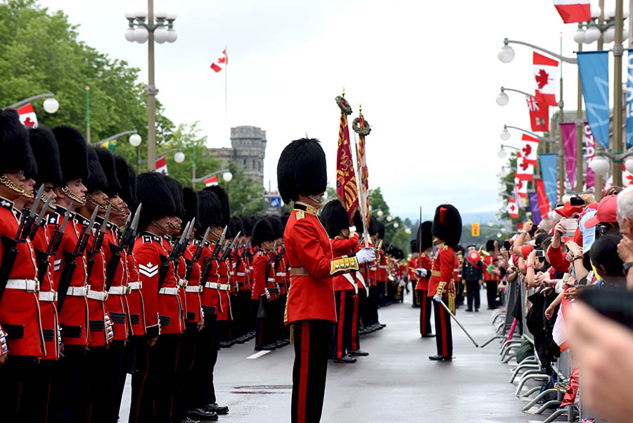 Members of the Ceremonial Guard conduct a Guard of Honour in Ottawa, Ontario on Canada Day in 2014 as the Canadian public looks on.