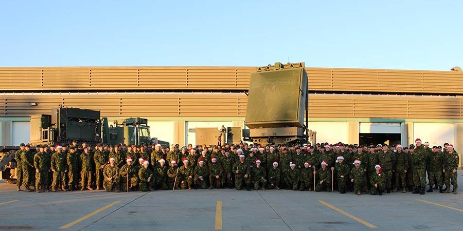Members of 4th Artillery Regiment (General Support), Royal Canadian Artillery pose with the newly-acquired Medium Range Radar (MRR) system in December, 2017 at 5th Canadian Division Support Base Gagetown. MRR allows soldiers to quickly locate and counter indirect fire threats such as rocket-propelled grenades and mortars. 
