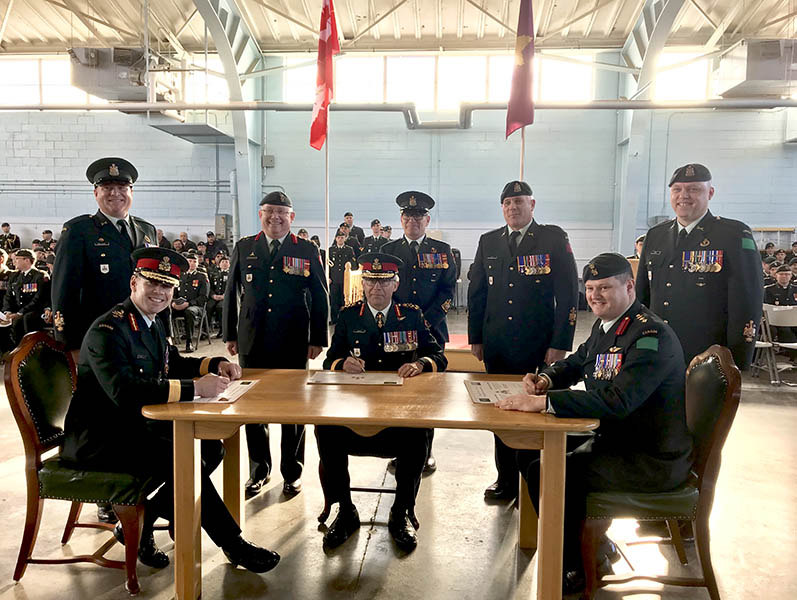 Signing the Transfer of Command certificate for the Canadian Combat Support Brigade
