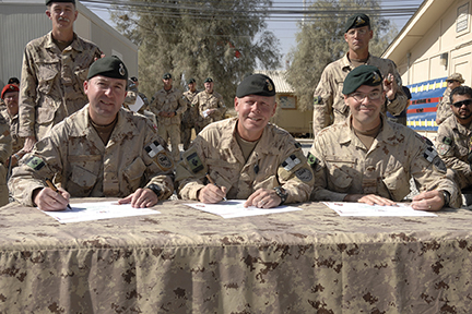 (Left to right) Lieutenant-Colonel Jerome Walsh, Brigadier-General Jonathan Vance and Lieutenant-Colonel Jocelyn Paul. L-Colonel Walsh of 1st Battalion, Princess Patricia's Canadian Light Infantry assumes command of Joint Task Force Afghanistan's Battle Group from LCol Paul of the 2e Battalion Royal 22e Régiment on October 15, 2009.The transfer of authority was conducted in the presence of Brigadier-General Jonathan Vance, Commander JTF Afghanistan. Photo: Master Corporal Matthew McGregor, Joint Task Force Afghanistan, Roto 8. ©2009 DND/MDN Canada.