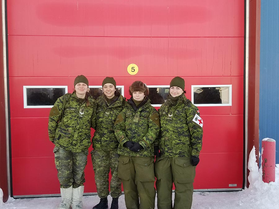 Members of the 38 Canadian Brigade Group (38 CBG)'s Arctic Response Company Group (ARCG) celebrate the success of Operation NUNALIVUT 2018. Pictured left to right, Corporal Jessica Kuzyk (38 Signal Regiment), Private Cassandra Bieniarz (17 Field Ambulance), Corporal Samantha Rohringer (Royal Winnipeg Rifles) and Corporal Janique Fillion (7 Field Ambulance). Photo: provided by Corporal Samantha Rohringer, Royal Winnipeg Rifles.