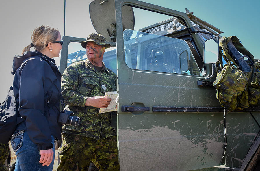 Sergeant Taylor Warren of The Fort Garry Horse gives his civilian employer Julie Baines of the Canada Border Services Agency a tour of a G-Wagon during Exercise ARMOURED BISON 2018 held at CFD Dundurn in Saskatchewan on April 28, 2018.