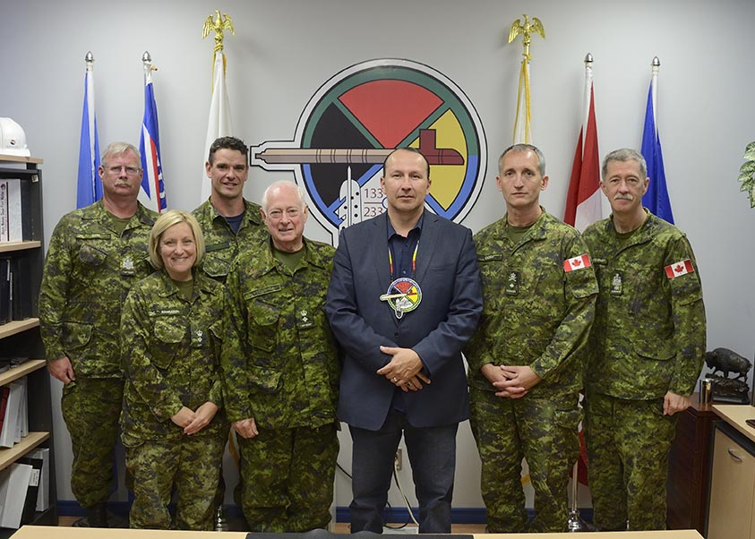 Members from 1 Military Police Regiment and 3rd Canadian Division, including Lieutenant Colonel Vanessa Hanrahan Commander, Canadian Army Military Police Group and Brigadier-General Trevor Cadieu, 3rd Canadian Division Commander,  meet with Chief Tony Alexis at the Band hall of Alexis Nakoda Sioux First Nation near Glenevis, Alberta, on May 30, 2018.