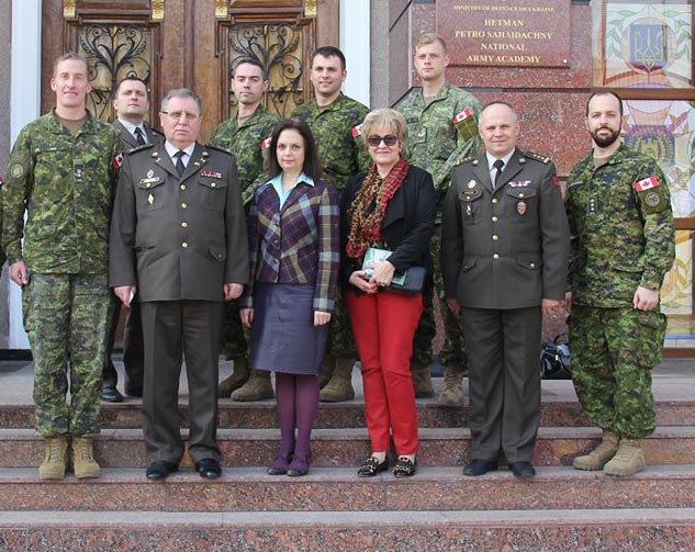 Roksolana Baran (wearing red) visits Lviv Land Forces Academy with Lieutenant-Colonel Fraser Auld, Commander Joint Task Force - Ukraine. On her left is Colonel Oleksii Krasiuk, Deputy Commander of the Academy and a former student at the Military Training and Cooperation Program at the Canadian Forces Language School Saint-Jean Detachment. Photo: Provided by Roksolana Baran. ©2018 DND/MDN Canada.