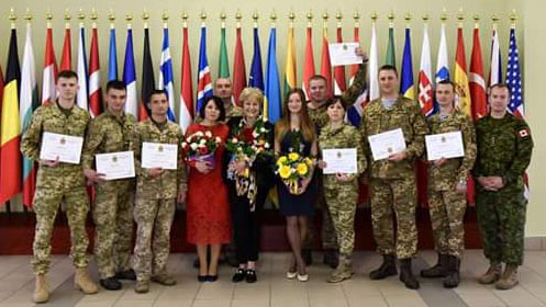 One of the three graduating classes with Roksolana Baran, Pedagogical Advisor, Canadian Forces Language School Detachment Saint-Jean (centre). Photo: Provided by Roksolana Baran. ©2018 DND/MDN Canada.