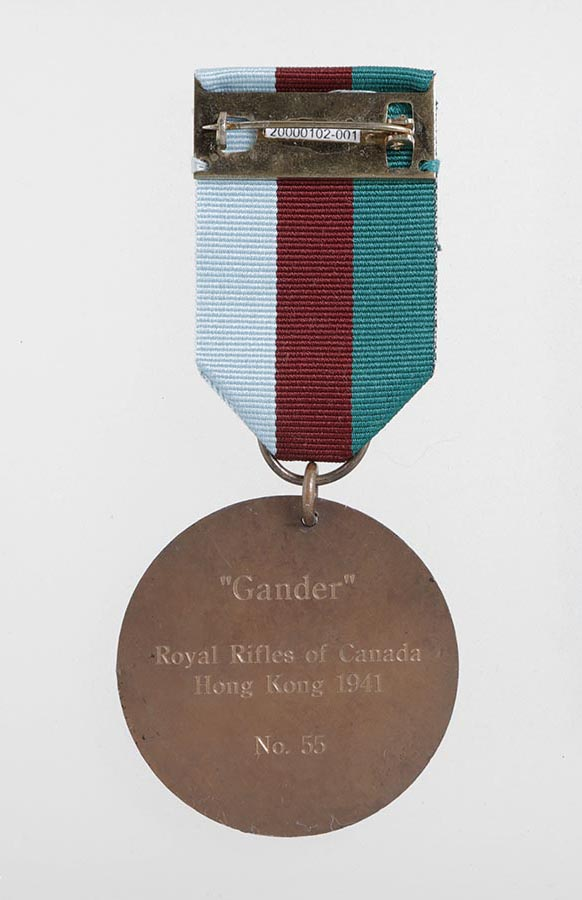 (Back view) Gander's Dickin Medal. CWM 20000102-001. Tilston Memorial Collection of Canadian Military Medals. Canadian War Museum.