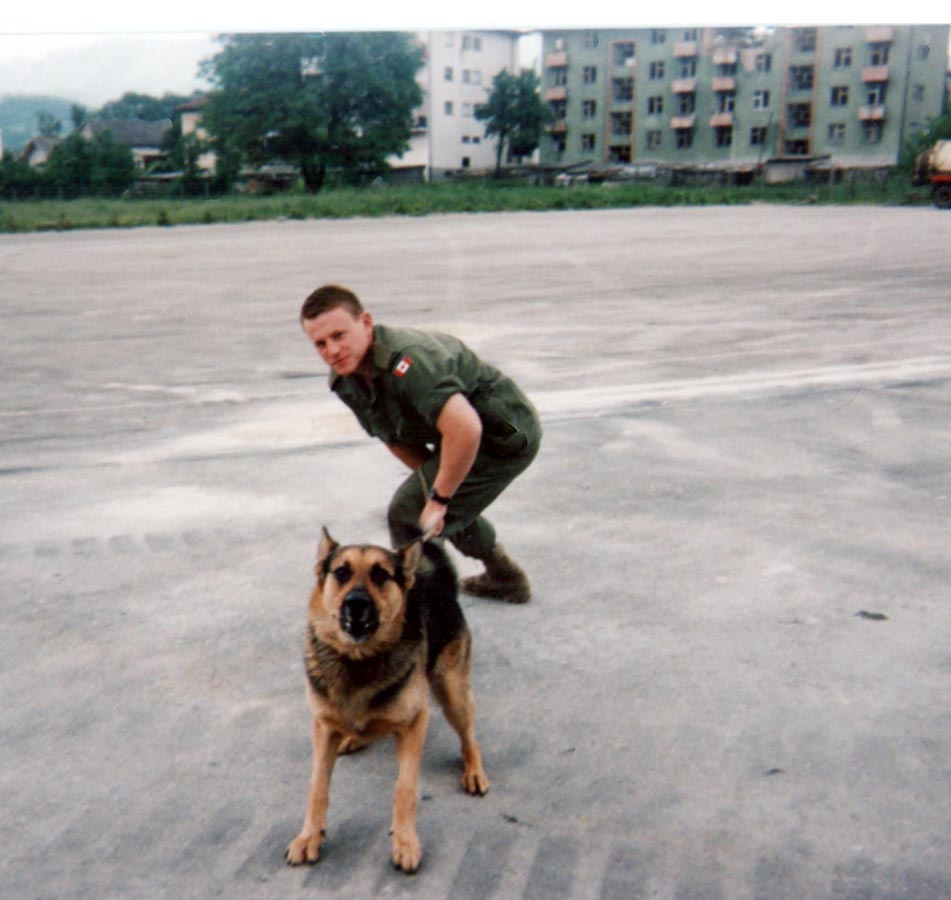 Sam with his Canadian handler, Corporal Michael (Scott) Moody of the The Royal Canadian Regiment in the former Yugoslavia in 1998. Sam was a German Shepherd with the British Royal Army Veterinary Corps on assignment with The Royal Canadian Regiment. Photo: Provided by Major Michael (Scott) Moody.