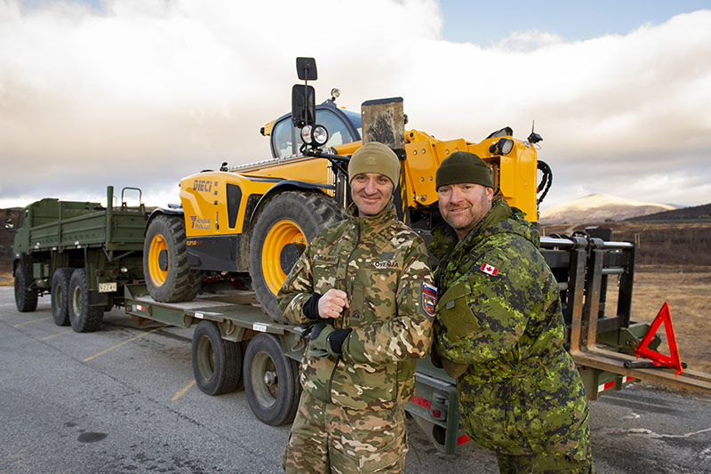 The Canadian Armed Forces assist the Slovenian Armed Forces by unloading cargo pallets during Exercise TRIDENT JUNCTURE 18 in Hjerkinn, Norway on October 18th, 2018.  Photo Credit: Cpl Lisa Fenton Canadian Forces Support Unit (Ottawa) Imagery Technician ©2018 DND-MDN Canada