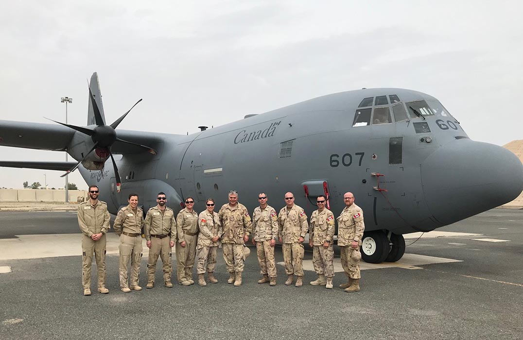 Honorary Colonel of the Canadian Army Paul Hindo (5th from right) with the CC-130H Hercules on which he travelled daily between Kuwait and Baghdad, Iraq. HCol Hindo recently visited with Canadian troops deployed to Iraq as part of Operation IMPACT, which is Canada's contribution to a global coalition that is training Iraqi security forces.  Photo: Provided by Honorary Colonel of the Canadian Army Paul Hindo