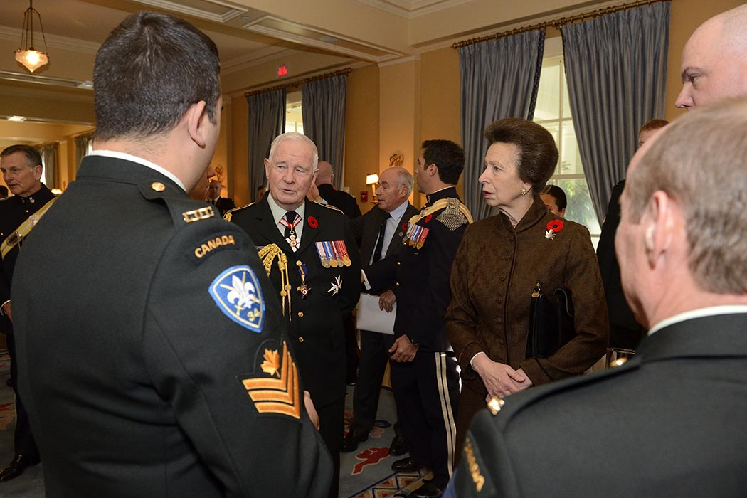 Then-Governor General of Canada David Johnston (centre left) and Her Royal Highness The Princess Royal, the Colonel-in-Chief of The Royal Canadian Hussars (Montreal) speak with members of the Regiment at Rideau Hall in Ottawa, Ontario on Remembrance Day 2014.  Photo: ©Office of the Secretary to the Governor General.