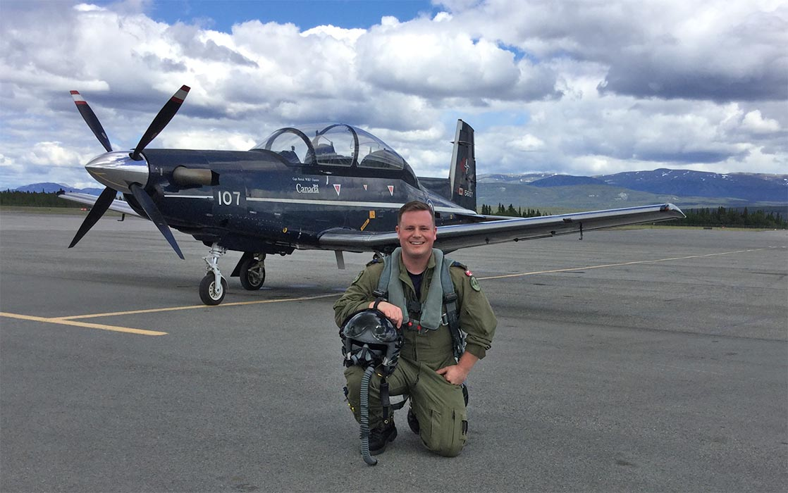 Captain Erik Temple pictured after landing at Erik Nielsen Whitehorse International Airport (which is named after his grandfather) in a CT-156 Harvard II. Capt Temple is a former Army musician and current Air Force flight instructor who recently reunited with his former unit to perform a flypast during the 2019 Fortissimo event in Ottawa.  Photo: provided by Captain Erik Temple.