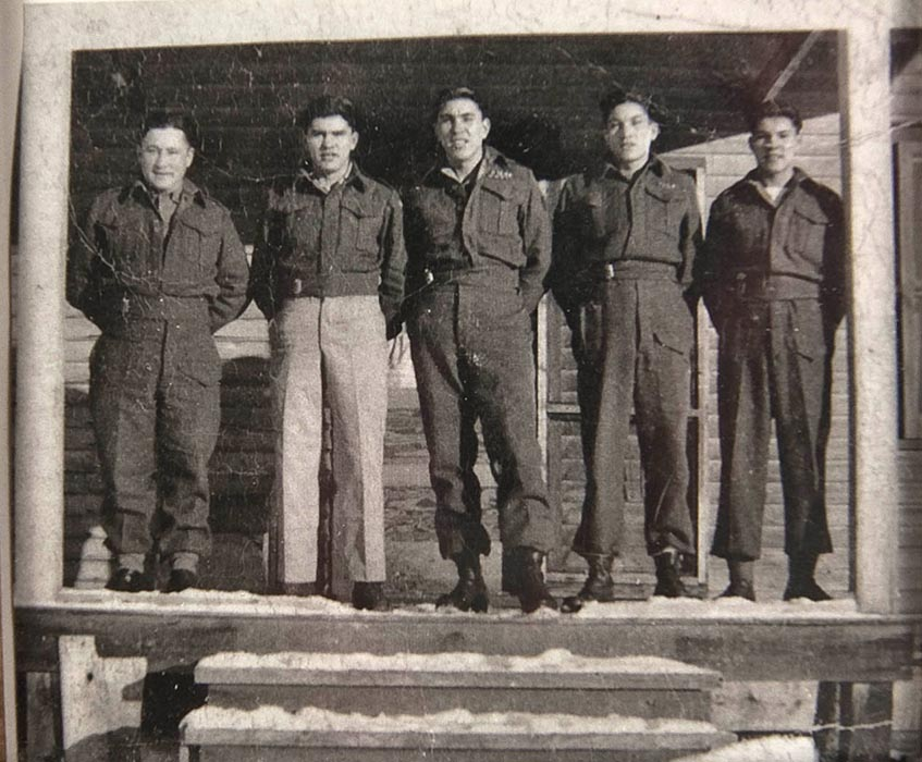 Corporal (Retired) Charles (Checker) Tomkins (second from right), was a Cree Code Talker during the Second World War. From left to right in 1945: John Smith (a stepbrother), Henry, Peter, Charles and Frank. John and Peter also served as Code Talkers. Photo: Courtesy of The Memory Project, Historica Canada.