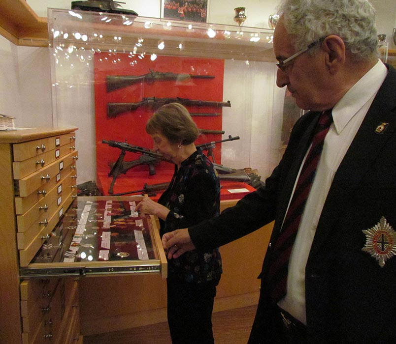 Master Warrant Officer (Retired) Martin Lane and Estelle Lane, his wife and co-curator of the Governor General's Foot Guards Regimental Museum, with the museum's collection of medals won by members throughout the regiment's history.  Photo: Steven Fouchard, Army Public Affairs. ©2019 DND/MDN Canada.