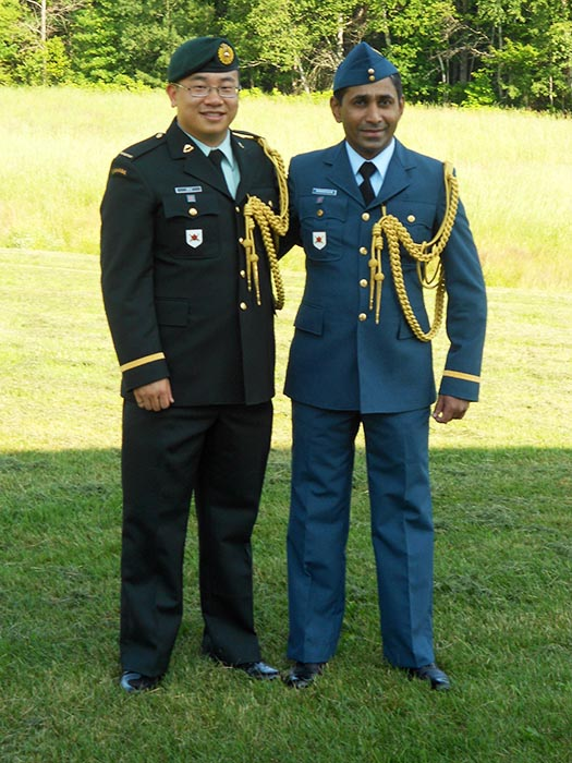 Second Lieutenant Yueshuang Zhu (left) and Second Lieutenant Udaya Ranasinghe (right) serve as Aides de Camp for Exercise UBIQUE on July 4, 2013 at the Canadian Forces School of Military Engineering at 5th Canadian Division Support Base Gagetown. Photo: ©2013 DND/MDN Canada.