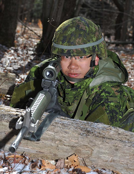 Officer Cadet Yueshuang Zhu trains with his C7 rifle during his Basic Military Officer Qualification at the Area Support Group Saint-Jean Training Area on March 26, 2012. Photo: ©2012 DND/MDN Canada.