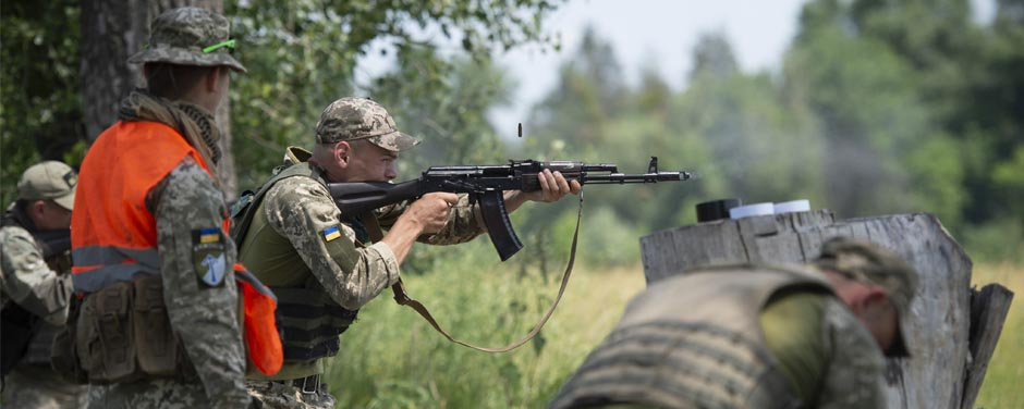 Slide - Canadian Armed Forces members support their British counterparts in offering training to Ukrainian Security Forces