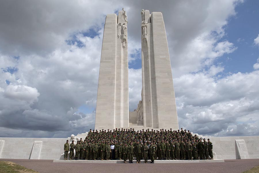 Members of the Canadian Armed Forces pose for a photo at the Canadian National Vimy Memorial prior to participating a commemorative parade in Vimy, France on July 12, 2019. Photo: Aviator Jérôme Lessard. ©2019 DND/MDN Canada.