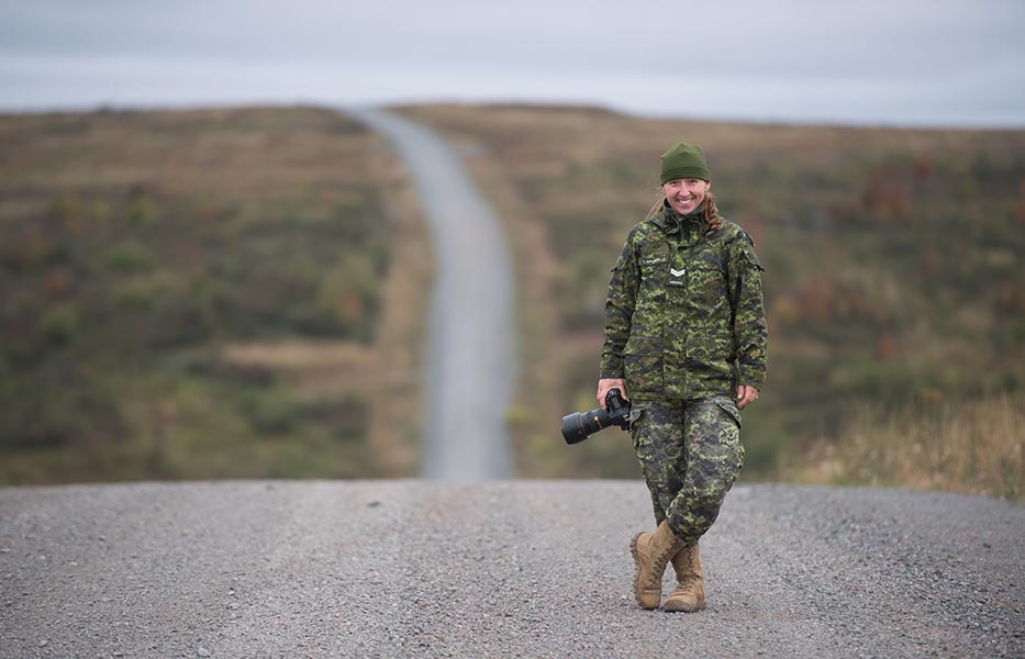 Corporal Genevieve Lapointe, a Canadian Army Imagery Technician, shot a series of individual soldier portraits this summer, one of which has been chosen to be displayed as part of an exhibit at the Canadian National Vimy Memorial in France. Photo: Corporal Nicolas Alonso, Tactics School, 5th Canadian Division Support Base Gagetown. 2019 DND-MDN Canada.