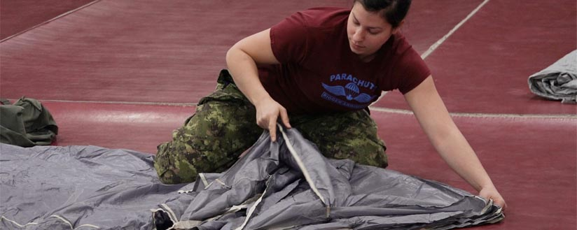 Slide - Pte Roy a packs the parachute