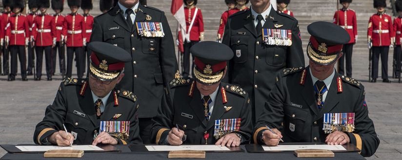 Slide - New commander signing documents